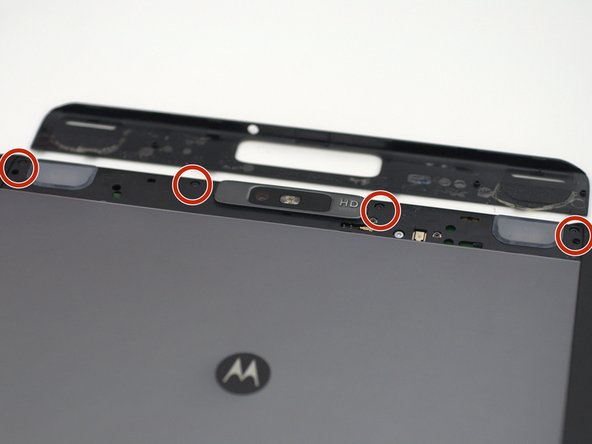 Using a T5 screwdriver, unscrew the four 1.5mm screws holding the main back cover. These screws are arranged in a line across the top of the back of the device.
