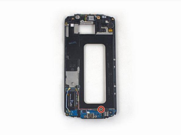 卸下一个将子板固定到显示框架的3.0mm Phillips #00螺丝