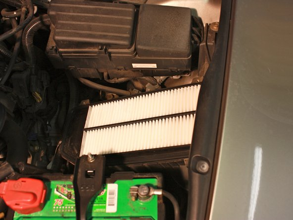 Image 1/1: Ensure that it seats properly in the lip of the air cleaner box.