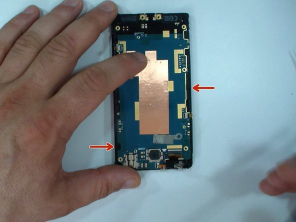 The logic board is secured to the display frame by two locking clips.