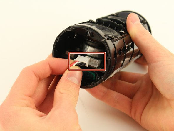 Remove the large white plug that connects the wires from the battery to the main board using your hands.