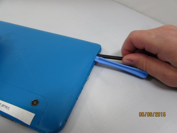 While holding the case open, insert the plastic opening tool to get a larger opening.