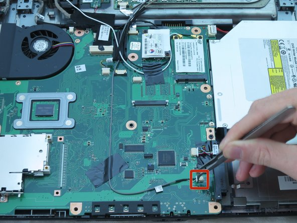 Image 1/3: Using your fingers, remove the large connector from the top right corner of the motherboard.