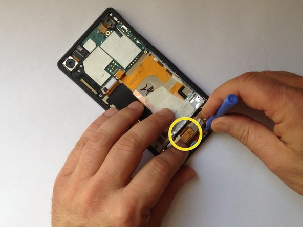 Disconnect the LCD Display flex cable.