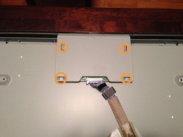 Remove four Phillips screws.
