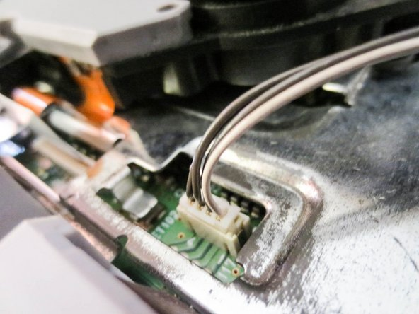 Take extreme care when disconnecting ribbon cable from motherboard. Tears extremely easy.