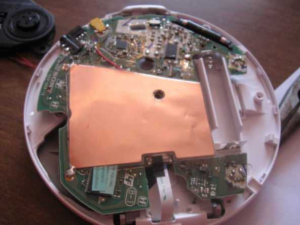 Now for the other side. Carefully peel up the antenna plate so you can get at the other data ribbon.