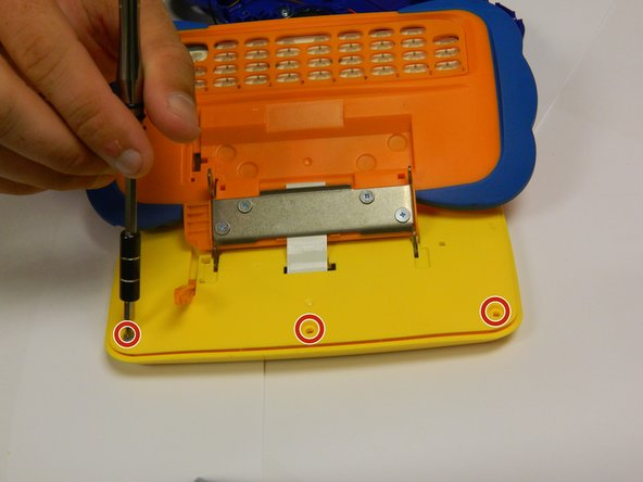 Flip the device over and remove the three 4.0 mm Philips J0 case screws.