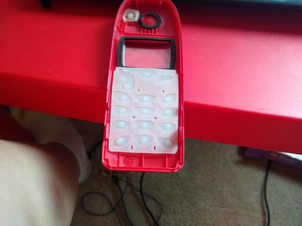 Pull off the number pad and store it some where safe, you'll need it for the new cover
