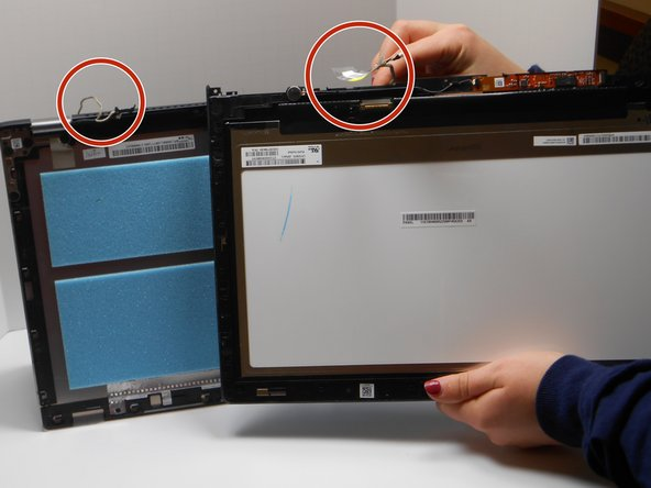 Image 1/1: Gently unsnap  the wire from the hooks along the perimeter, also removing any tape along the wire.