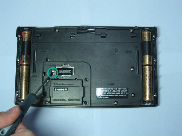 Using the same screwdriver, unscrew the 4.6mm screw located under the panel and left of the backup battery.