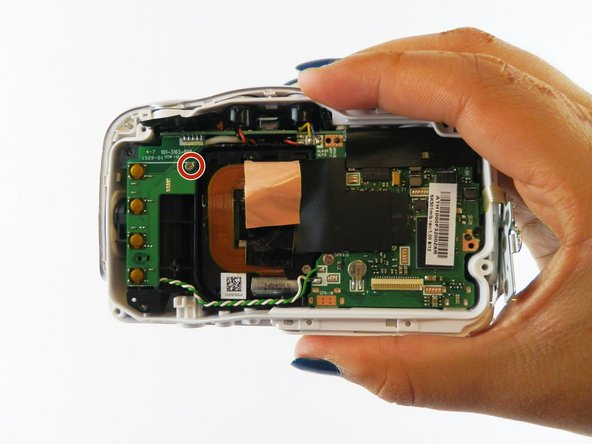 After removing the LCD holder, you can begin the process of removing the speaker from the camera.