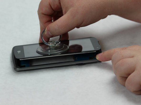 Use the small suction cup to remove the screen.
