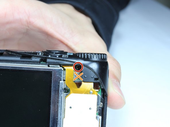 Remove the internal 4.4mm screw with a Phillips 00 screwdriver.