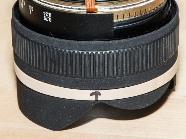 Drop on the focus indicator ring. There are shallow indents on the bottom that engage the tabs on the bearing plates. (Shown here in an assembled state.)