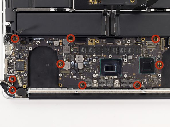 Image 1/1: Remove the nine 3.3 mm T5 Torx screws securing the logic board and MagSafe DC-in board to the upper case.