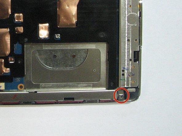Using the same screwdriver, remove the 1.4 mm screw that is located on the back of the device.