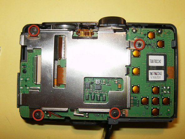 Image 3/3: Remove the four screws from the LCD holder.