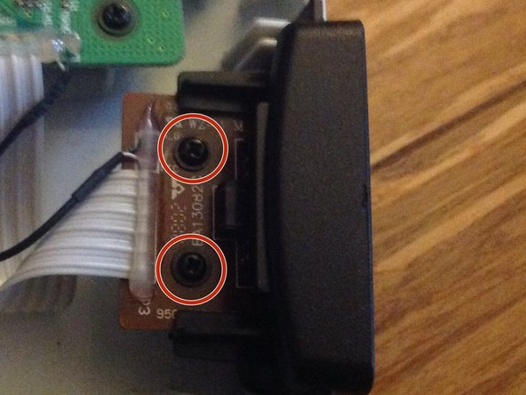 Unscrew these 2 Philips head screws.