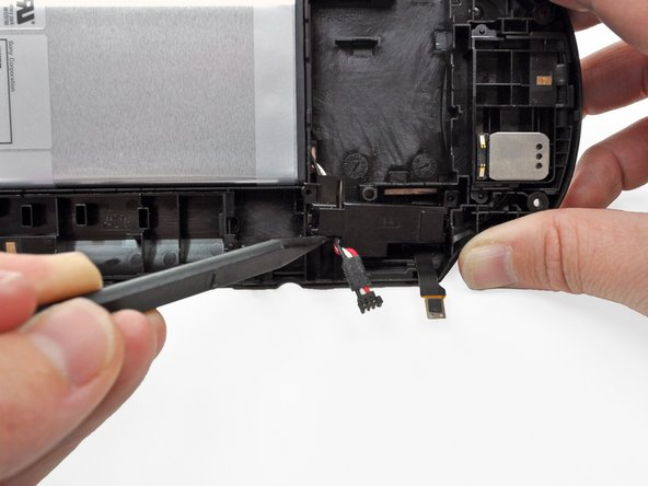 Image 1/2: The easiest access to the battery cable retainer is where the battery cable comes out.