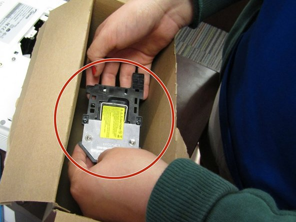 Open and remove the new light bulb from its box with clean hands to prevent from getting the bulb dirty.