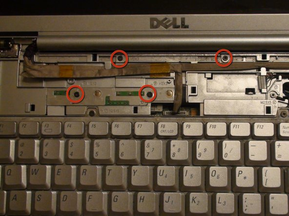 Image 1/3: Remove the four screws with a Phillips #1 screwdriver.