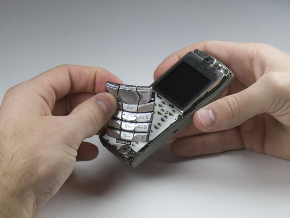 Lift the keypad off of the keyboard as it is not attached to the phone anymore.