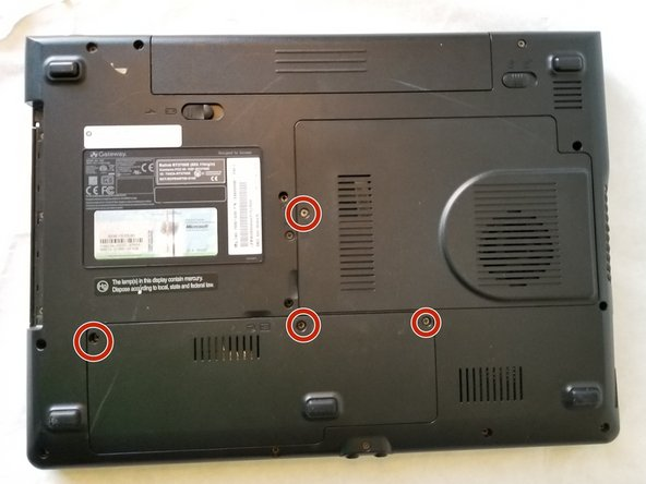 Using the Phillips #1 screwdriver, remove the four 6mm screws on the back of the laptop.