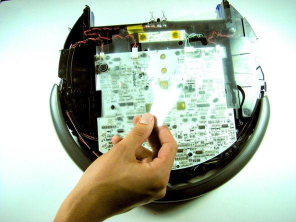 Image 3/3: Lift the control panel off, then lift the clear plastic motherboard protecting sheet and set both aside.