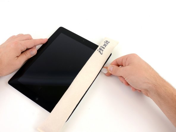 Image 2/2: Remove the plastic opening tool from the iPad, and push the opening pick further underneath the front glass to a depth of ~0.5 inches.