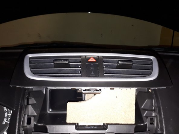 Use the door panel removal tools to pry open the top cover.