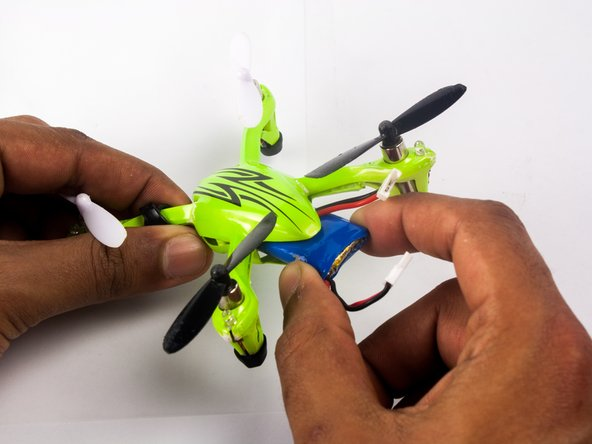 Grip the battery and slide it out of the quadcopter body.