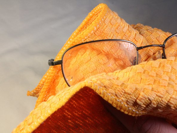 Image 2/3: To dry off glasses and remove any remaining wax on the lenses, wipe them off using a clean cloth.