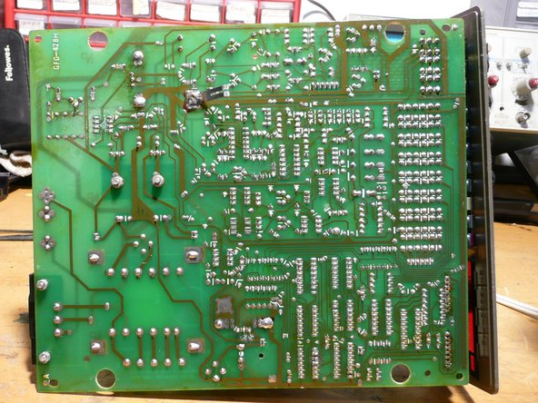 Back of the PCB. The metal tab you see sticking out of the boards towards the middle is connected to the metal shielding shown in the earlier steps (step 3).