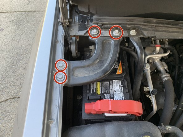 Remove the four bolts holding the engine bay brace to the body of the truck with a 13mm socket and socket wrench. Remove the brace and set it off to the side.