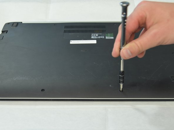 Use a Philips Head PH1 screwdriver to remove 10 screws (3 10mm screws and 7 5mm screws) around the perimeter of the back plate.