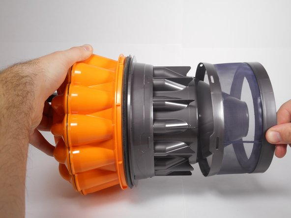 After releasing all of the notches, pull the filter away from the orange cyclone assembly to remove it from the bin.