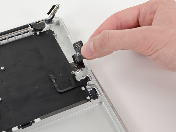Image 2/2: Lift and remove the headphone jack out of the upper case.