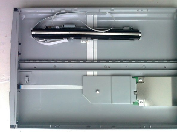 Now gently lift the scanner head off the grey plastic rail and place it to one side of the case out of the way.