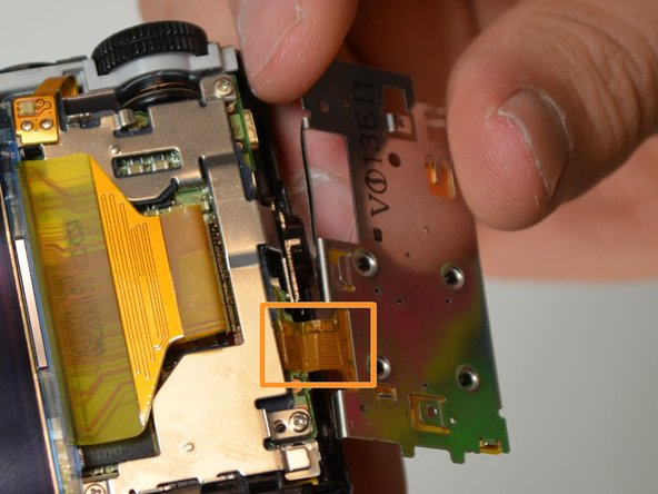 Be careful not to damage the ribbon cable that is still attached to the camera.