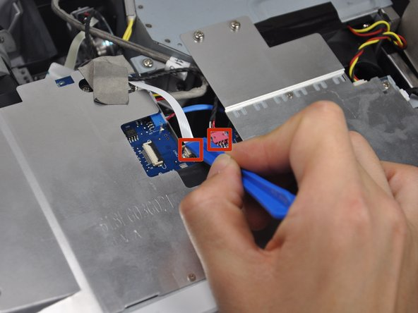 Use the plastic opening tool to remove the wiring.