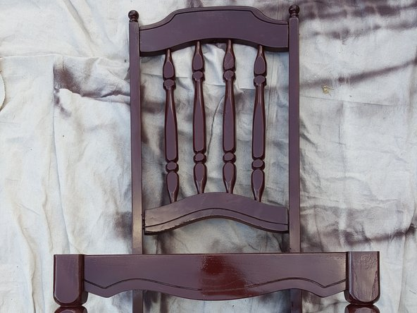Apply a second light coat over the front of the chair and allow it to dry for 10 minutes.