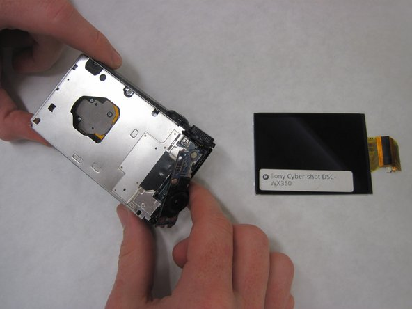 Take the LCD off by undoing the zif and sliding it out.