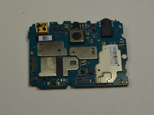 With the motherboard removed from the device, turn the motherboard over to face the obverse side.