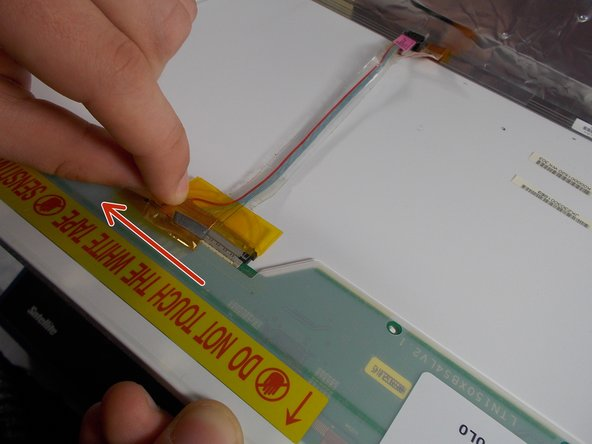 Hold one side of the tape on the cable, and gently pull down along the screen.