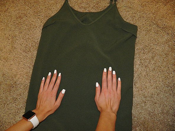 Turn your dress inside out and lay it on a smooth surface.