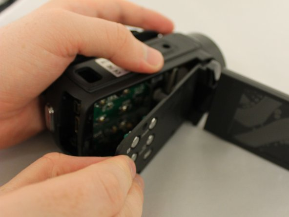 Use a plastic pick to pry off the side face of the device and carefully remove the side face.