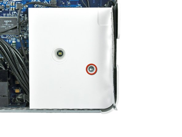 Image 1/2: Remove the single T10 Torx screw securing the right speaker to the logic board.