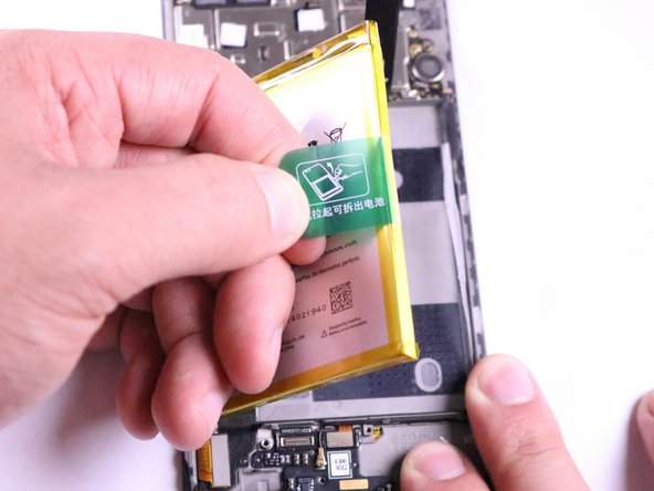 This will create a ripping sound. This is because of the adhesive on the back of the battery and is completely normal.