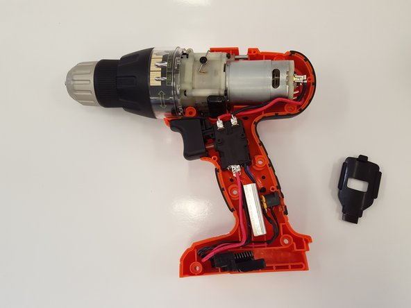 When separating the drill casing, the black plastic speed switch covering will be removed from the drill automatically.